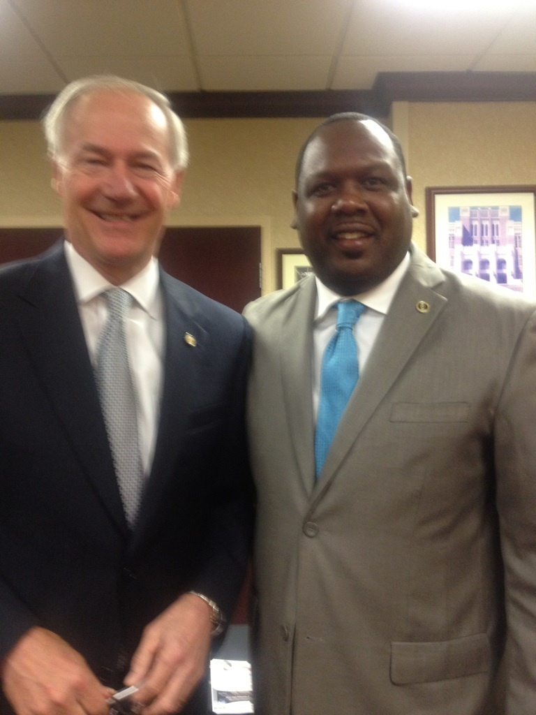DuShun pauses for a photo with Gov. Hutchinson